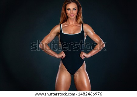 Beautiful fitness woman athlete and bodybuilder with perfect body wearing sport clothes for the gym training. Individual sports. Sports recreation. #1482466976