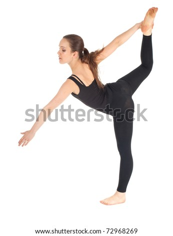 beautiful fitness woman doing stretching exercise  holding one leg above , isolated