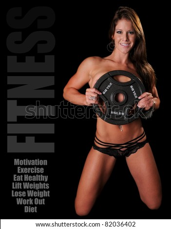 Beautiful Fitness Woman Holding Weights