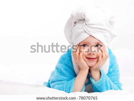beautiful five year old girl  after the shower on the bed at home