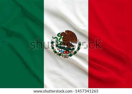 beautiful flag of mexico on delicate silk with soft folds in the wind #1457341265