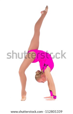 Beautiful flexible girl gymnast staying in a handstand over white background