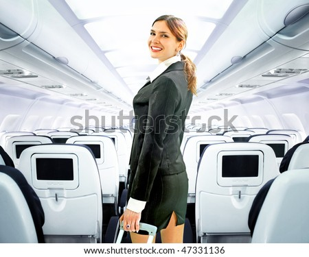 beautiful flight attendant on board of big plane