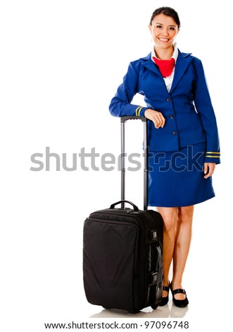 Beautiful flight attendant with her bag �¢?? isolated over white