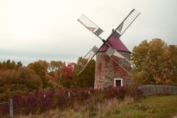 Beautiful flour mill on Isle aux Coudres, Quebec, Canada in autumn