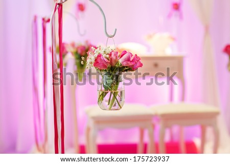 Beautiful flower arrangement in white and pink for wedding ceremony