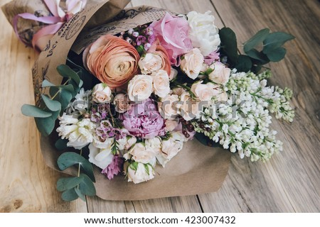 Beautiful flower bouquet on the wooden table background