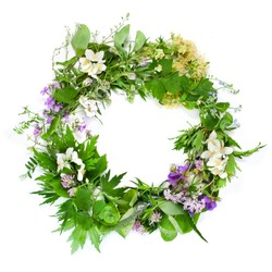 Beautiful flower wreath with colorful flowers isolated on a white background. Midsummer celebration concept, summer decoration.