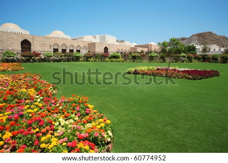 beautiful flowers and other vegetation in garden inside Sultan's Palace in Oman.
