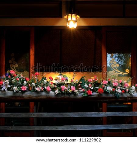 beautiful flowers and warm lamp