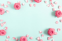 Beautiful flowers composition. Pink rose flowers on pastel blue background. Valentines Day, Easter, Birthday, Mother's day. Flat lay, top view, copy space