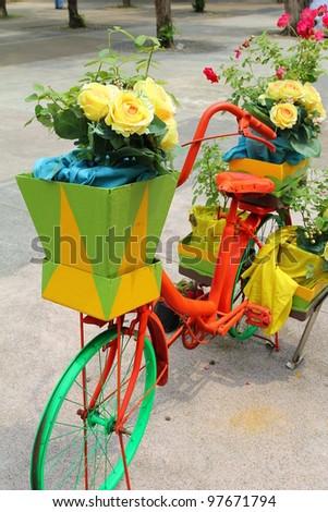 beautiful flowers in bicycle basket