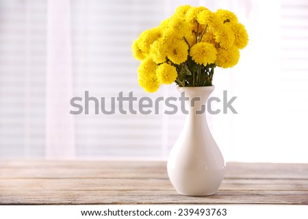Beautiful flowers in vase with light from window #239493763