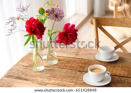 Beautiful Flowers In Vases As Floral Decor On Wooden Table Ez Canvas