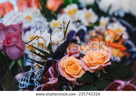 Beautiful flowers on table in wedding day. Table decor with flowers table numbers and candles.
