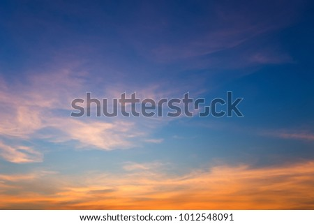Beautiful fluffy clouds with evening sunset background. #1012548091