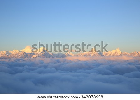 beautiful fog among sunrise  frozen mountain summits landscape #342078698