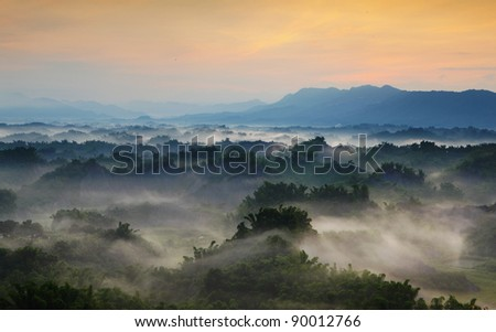 Beautiful fog with mountains - stock photo