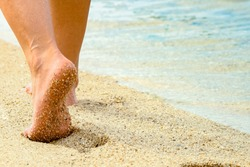 beautiful footprints in the sand by the sea background