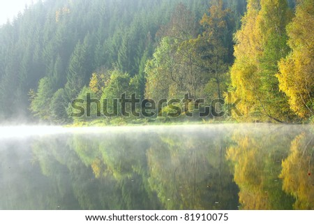 Beautiful forest lake in the autumn morning - stock photo