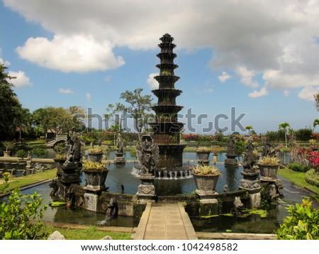Beautiful former Royal Water Garden in blue sky and clouds background.  Tirga Gangga, Bali, Indonesia. #1042498582