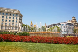 Beautiful fountain and gardens at the centre of the city in the downtown area, Placa de Catalunya or Catalonia Square, Barcelona, Spain.