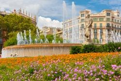 Beautiful fountain at Plaza Catalunya or Catalonia Square in Barcelona at sunny summer day, Catalonia, Spain