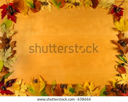 Beautiful frame of autumn leafs on wood background, very warm