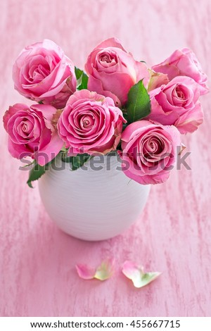 Beautiful Fresh Roses Flowers In A Vase On A Pink Background Ez