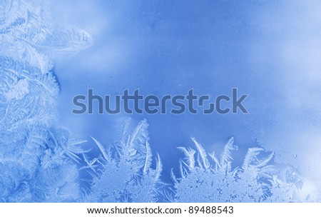Beautiful frost pattern on a window glass, with empty space for your text or image (as a New Year background)