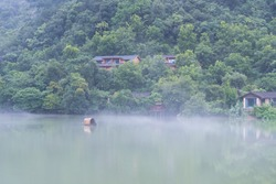 beautiful fuchun river scene,  houses by the river were foggy, hangzhou city, zhejiang province, China