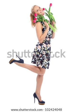 Beautiful full body woman with red tulips bouquet of flowers smiling isolated on white background