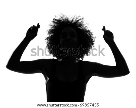 beautiful funny young afro american woman crossed fingers gesture in silhouette shadow on studio isolated white backgroung