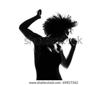 beautiful funny young afro american woman dancing in silhouette shadow on studio isolated white backgroung