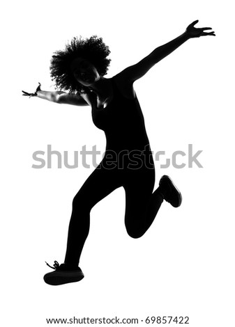 beautiful funny young afro american woman happy jumping in silhouette shadow on studio isolated white backgroung