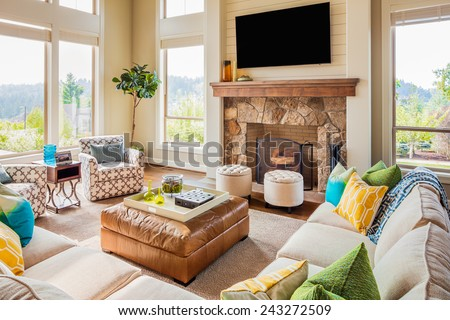 Beautiful Furnished Living Room in Luxury Home with Fireplace and Television