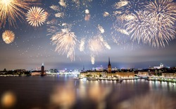 Beautiful Gamla Stan in Stockholm at new year's eve with magical fireworks.