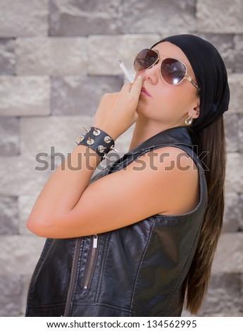Beautiful gang woman smoking.