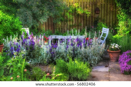Beautiful garden at sunset - flowers and furniture