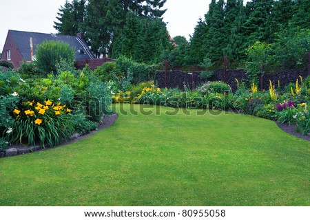 Beautiful Garden. Green Lawn in Landscaped Formal Garden.