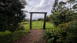 Beautiful Garden Rock Path with Timber Log Archway Looking Out Over Incredible Country Side | Montville Queensland