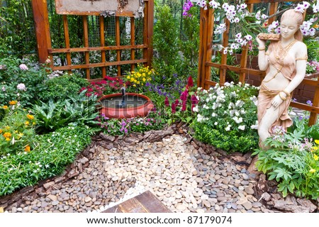 beautiful garden with small fountain