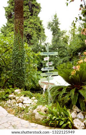 Beautiful garden with the pointers of directions #1322125949