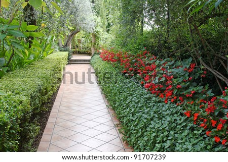 Beautiful garden with walkway - stock photo