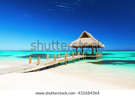 Stock Photo Beautiful gazebo on the tropical white sandy beach in Punta Cana, Dominican Republic