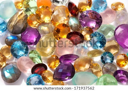 Beautiful gems background. Photo of a sparkling and colorful real gemstones in natural sunlight.