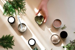 Beautiful gentle background of the process of making natural cosmetics from clay.
