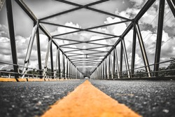 beautiful geometric design of the bridge with yellow line on the road