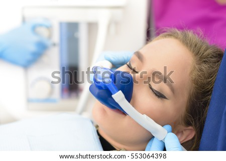 Shutterstock Beautiful getting woman inhalation sedation at dental clinic