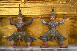 Beautiful Giants statue decorated exterior at the Emerald Buddha temple architecture in Wat Phra Kaew at the Grand Palace in Bangkok, Thailand, Asia. Tourism concept.